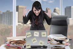 Female secretary looks frustrated in the office Stock Photos