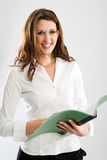 Female secretary with open folder Royalty Free Stock Photos