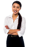 Female secretary posing with arms crossed Royalty Free Stock Photography