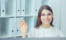 Female secretary says hello with hand. Friend welcome, introduction, greet or thanks gesture, product advertisement. Partnership approval, arm, strike a stock photos