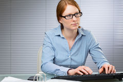 Female Secretary at Work Stock Photography