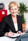 Female secretary writing on notepad Stock Photo