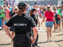 Female security guard keeps an eye on the public royalty free stock photography