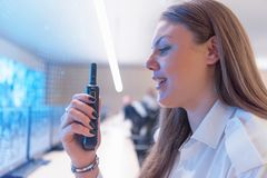 Free Female Security Guard Operator Talking On The Phone, Calling In The Alarming Event To The External Team Of Field Force Agents Royalty Free Stock Photo - 165069865