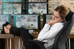 Female security guard sleeping at workplace. royalty free stock images