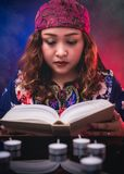 Female seer teller doing psychic reading book. For predicting fate Stock Images