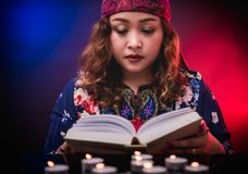 Female seer teller doing psychic reading book. For predicting fate royalty free stock photos