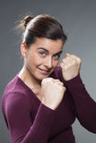 Female self-defense concept for attractive 30s woman Stock Photo