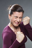 Female self-protection concept for 30s woman. Female self-defense concept - bullied 30s woman creasing her eyes in fight training or hating violence,studio shot Stock Photos
