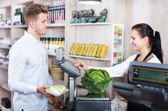 Female seller assisting customer in grocery shop Royalty Free Stock Photography