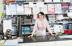 Female seller behind the counter Royalty Free Stock Photography