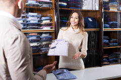 Female seller in clothes store Stock Photography