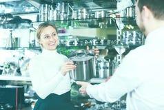 Female seller in dinnerware store Stock Image