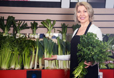 Female seller offering good price for vegetables Royalty Free Stock Photos