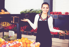 Female seller showing assortment Royalty Free Stock Photo