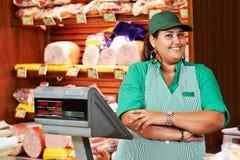 Female seller in supermarket shop stock photos