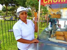 Female sells of traditional dessert churros, Lima, Peru royalty free stock photos