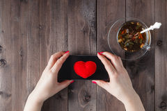 Female send heart by sms Stock Images
