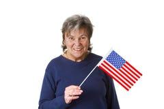 Female senior with amercan flag. Isolated on white background Stock Images