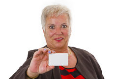 Female senior with business card Royalty Free Stock Image