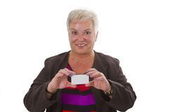 Female senior with business card Stock Image