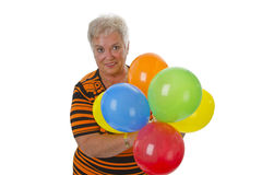 Female senior with colorful ballons Royalty Free Stock Photos