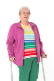 Female senior with crutches Stock Photography