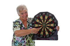 Female senior with darts Royalty Free Stock Photography