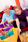 Female senior and daughter become a lot of gifts Royalty Free Stock Images