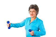 Female senior with dumbbell Royalty Free Stock Images