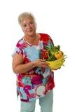Female senior with fresh vegetables Royalty Free Stock Photo