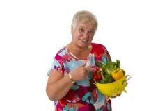 Female senior with fresh vegetables Stock Images