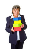 Female senior with gift boxes Royalty Free Stock Photo