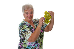 Female senior with grapes Stock Photos