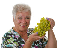 Female senior with grapes Royalty Free Stock Photography