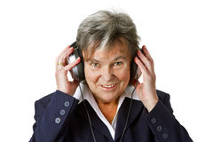 Female senior with headphone Royalty Free Stock Images