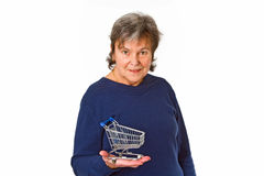 Female senior holding empty model shopping trolley Royalty Free Stock Image