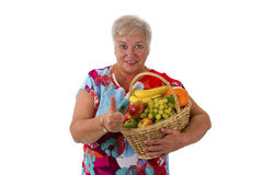 Female senior holding fruit basket Royalty Free Stock Photography