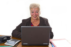 Female senior with laptop Royalty Free Stock Photo