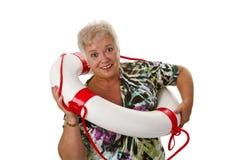 Female senior with life belt Stock Photo