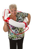 Female senior with life belt Stock Photos