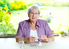 Female senior with a lot of medicament Royalty Free Stock Images