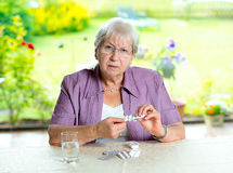 Female senior with a lot of medicament Royalty Free Stock Photo