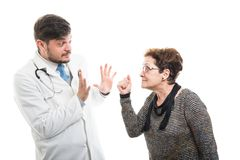 Female senior patient showing fist to male doctor. Isolated on white background Stock Photo