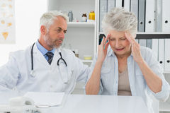 Female senior patient visiting doctor Stock Photos