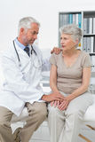Female senior patient visiting a doctor Stock Image