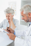 Female senior patient visiting a doctor Stock Photo
