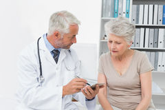 Female senior patient visiting a doctor Stock Images