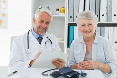 Female senior patient visiting doctor Royalty Free Stock Image