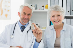 Female senior patient visiting doctor Stock Image